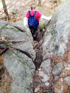 Bill descending the narrow rocky passageway